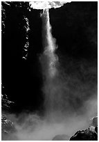 Bridalveil Falls as sun reaches upper shaft of water. Yosemite National Park, California, USA. (black and white)