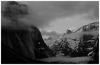 Valley view with fog, winter sunset. Yosemite National Park, California, USA. (black and white)