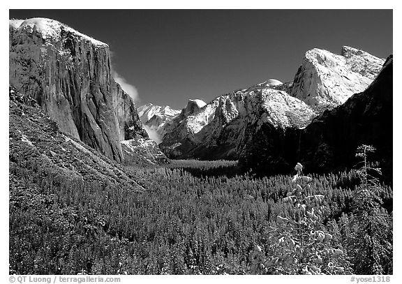 Yosemite Valley from Tunnel View in winter with snow-covered trees and mountains. Yosemite National Park (black and white)