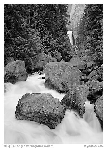 Boulders in frosty Merced River and distant Vernal Fall. Yosemite National Park (black and white)