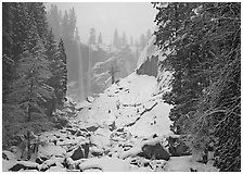Thin flow of Vernal Fall in winter. Yosemite National Park ( black and white)