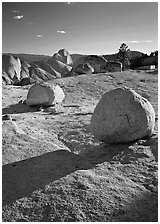 Glacial erratic boulders and Half Dome, Olmsted Point, afternoon. Yosemite National Park ( black and white)