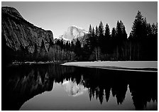 Half-Dome reflected in Merced River near Sentinel Bridge, sunset. Yosemite National Park, California, USA. (black and white)