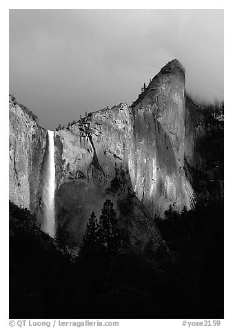 Bridalveil Falls and Leaning Tower, stormy sky. Yosemite National Park (black and white)
