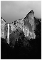 Bridalveil Falls and Leaning Tower, stormy sky. Yosemite National Park, California, USA. (black and white)