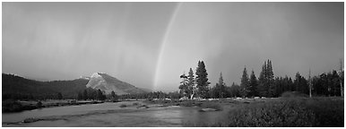 Evening storm with rainbow over Tuolumne Meadows. Yosemite National Park (Panoramic black and white)