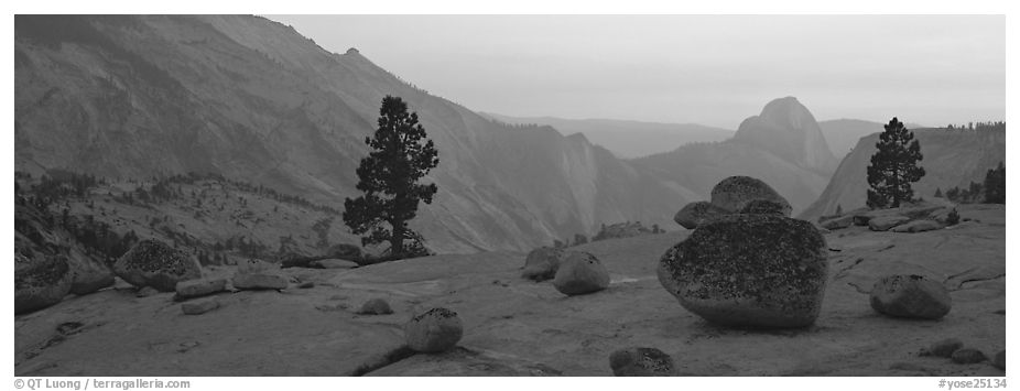 Erratic glacial boulders and Half-Dome at sunset. Yosemite National Park (black and white)