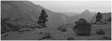 Erratic glacial boulders and Half-Dome at sunset. Yosemite National Park (Panoramic black and white)