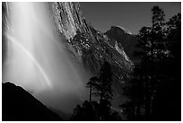 Upper Yosemite Falls with double moonbow and Half-Dome. Yosemite National Park, California, USA. (black and white)