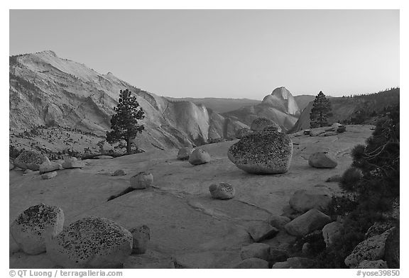 Glacial erratic boulders, Clouds Rest, and Half-Dome from Olmstedt Point, dusk. Yosemite National Park (black and white)