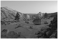 Glacial erratic boulders, Clouds Rest, and Half-Dome from Olmstedt Point, dusk. Yosemite National Park, California, USA. (black and white)