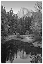 Half Dome reflected in Merced River at sunset. Yosemite National Park, California, USA. (black and white)