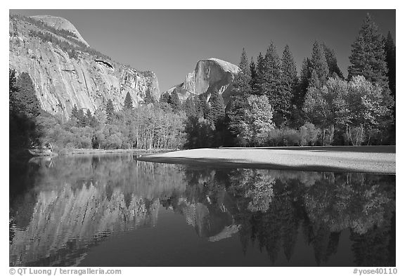 North Dome and Half Dome reflected in Merced River. Yosemite National Park (black and white)