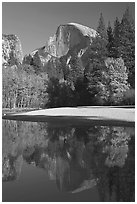 Half Dome reflected in Merced River in the fall. Yosemite National Park, California, USA. (black and white)