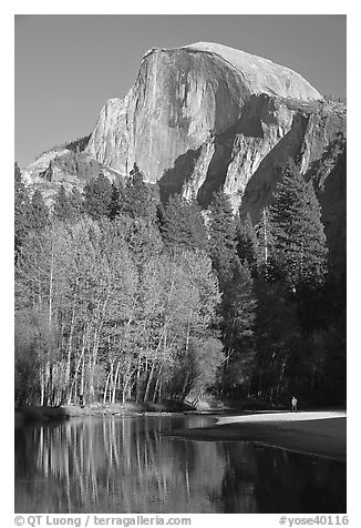 Banks of  Merced River with hiker below Half-Dome. Yosemite National Park (black and white)