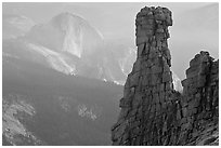 Rock tower and Half-Dome. Yosemite National Park, California, USA. (black and white)