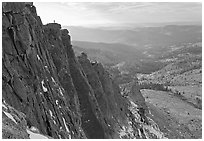 Cliffs on  North Face of Mount Hoffman with hiker standing on top. Yosemite National Park, California, USA. (black and white)