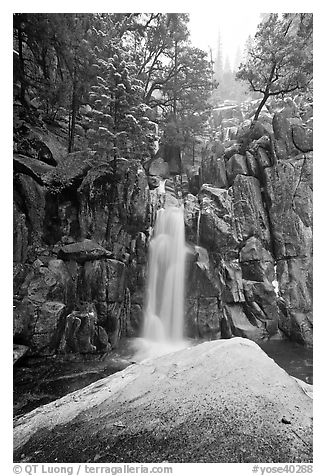 Snow-covered boulder and base of Chilnualna Falls. Yosemite National Park (black and white)
