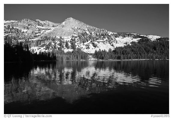 Tenaya Lake, with partly snow-covered peak reflected. Yosemite National Park (black and white)