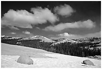 Snow on slab, boulders, and distant domes, Tuolumne Meadows. Yosemite National Park, California, USA. (black and white)
