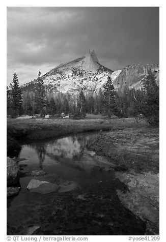 Cathedral Peak reflected in stream under stormy skies. Yosemite National Park (black and white)