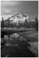Cathedral Peak reflected in stream under stormy skies. Yosemite National Park ( black and white)