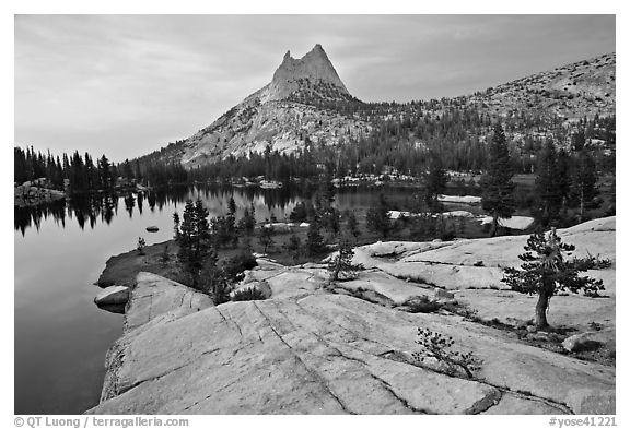 Granite slab, Upper Cathedral Lake, and Cathedral Peak, sunset. Yosemite National Park (black and white)