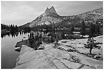 Granite slab, Upper Cathedral Lake, and Cathedral Peak, sunset. Yosemite National Park ( black and white)