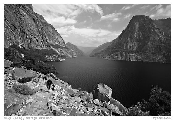 Father hiking with boy next to Hetch Hetchy reservoir. Yosemite National Park (black and white)
