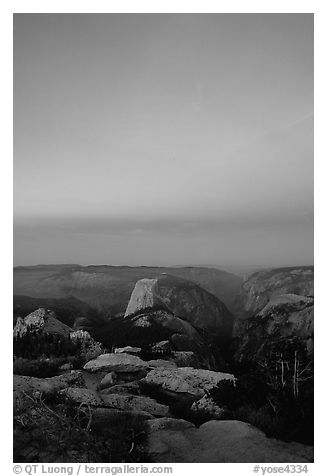 Half-Dome and Yosemite Valley under  pink hues of dawn sky. Yosemite National Park (black and white)
