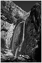 Lower Yosemite Falls and rock wall with snowy trees on rim. Yosemite National Park ( black and white)