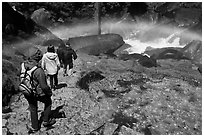 Hikers walking through rainbow, Mist Trail. Yosemite National Park, California, USA. (black and white)