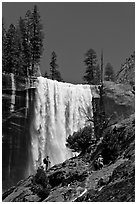 Hikers standing on Mist Trail below Vernal Fall. Yosemite National Park, California, USA. (black and white)