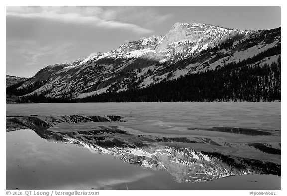 Tenaya Peak reflected in partly iced Tenaya Lake. Yosemite National Park (black and white)