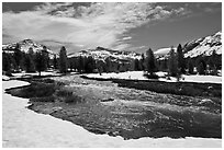 Creek flowing in snow-covered high country landscape. Yosemite National Park ( black and white)