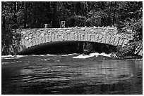 Pohono Bridge with high waters. Yosemite National Park, California, USA. (black and white)