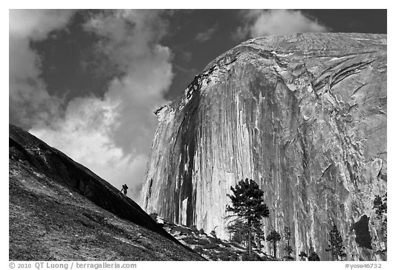 Hiker near Diving Board and Half-Dome. Yosemite National Park (black and white)