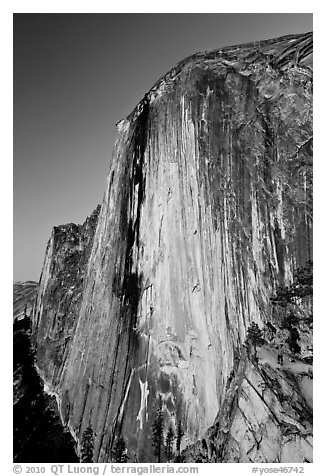 Hiker at the base of Half-Dome at dusk. Yosemite National Park (black and white)