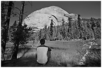 Hiker looking at backside of Half-Dome from Lost Lake. Yosemite National Park ( black and white)