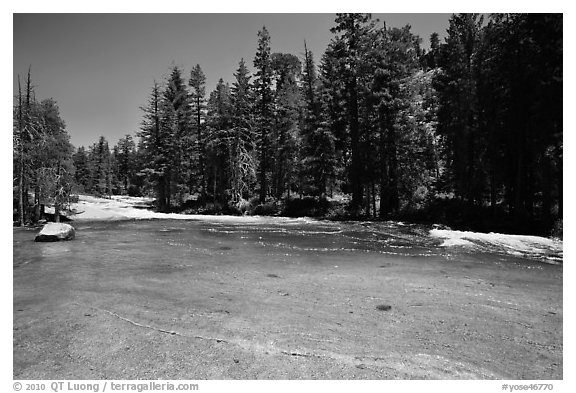 Merced River flowing over smooth granite. Yosemite National Park (black and white)
