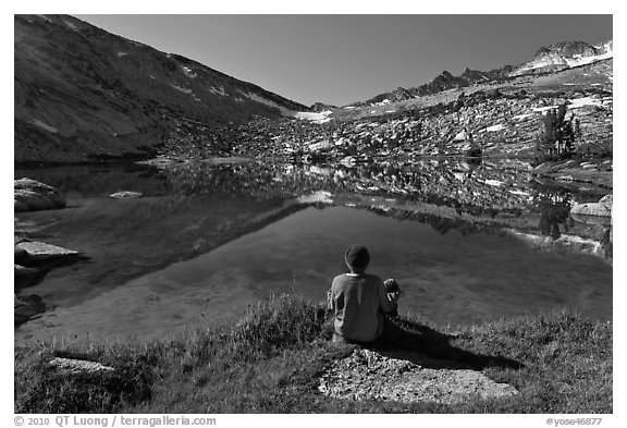 Hiker sitting by alpine lake, Vogelsang. Yosemite National Park (black and white)