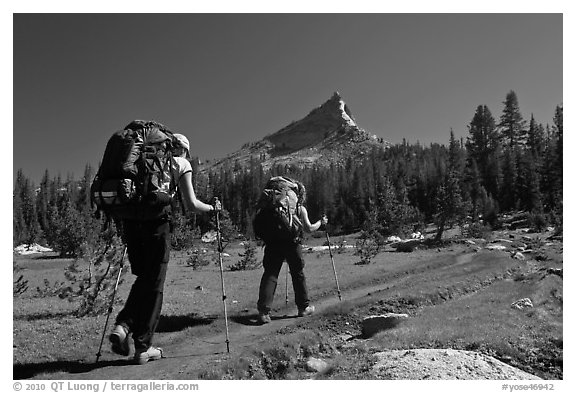 Women backpacking on John Muir Trail below Tressider Peak. Yosemite National Park (black and white)