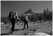 Women backpacking on John Muir Trail below Tressider Peak. Yosemite National Park ( black and white)