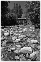 Pebbles in river and covered bridge, Wawona. Yosemite National Park, California, USA. (black and white)