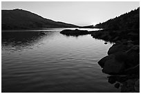 Sun setting over Upper McCabe Lake. Yosemite National Park, California, USA. (black and white)