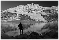 Hiker silhouette on Roosevelt lakeshore. Yosemite National Park ( black and white)