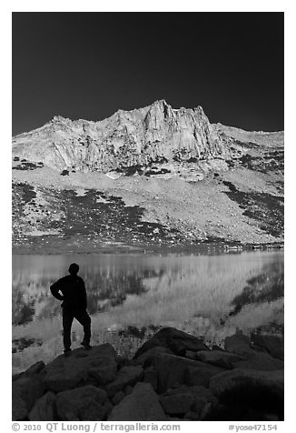 Hiker standing  on Roosevelt lakeshore. Yosemite National Park (black and white)