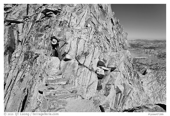 Hiker on summit block of Mount Conness. Yosemite National Park (black and white)