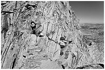 Hiker on summit block of Mount Conness. Yosemite National Park ( black and white)