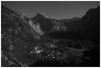 Yosemite Village lights and Half-Dome by moonlight. Yosemite National Park, California, USA. (black and white)
